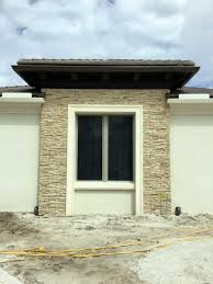 exterior window trim with stacked stone casing and sill