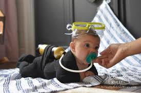 i also used the tub from my nose frida to connect the binky and the air tank lastly i grabbed some kids goggles for the top of her head