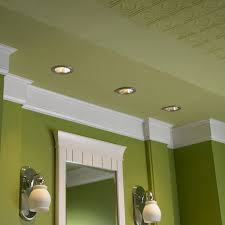 recessed lights paired with wall sconces in the same finish
