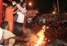 Roasting girl over fire