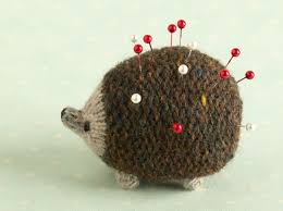 you can use any spare wool you have to make this super cute hedgehog pin cushion