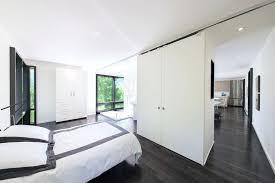 modern white floors. Contemporary Wood Flooring Dark Floors Bedroom Modern With Built In Bathtub Black And White Bedding .