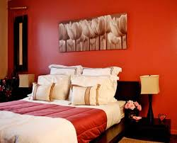 cool modern bedroom color design ideas with walls painted of light red also black wooden bedframe charming bedroom ideas red