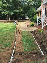 install irrigation system pipe along walkway