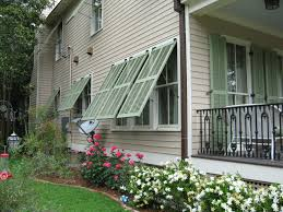 exterior bahama shutters lowes. enchanting wood siding with bahama shutters and dark metal railing for traditional exterior home design lowes