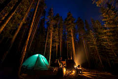 camping in the woods at night. Wonderful Woods Summer Camping In The Woods With A Fire Two People Around Fire On Camping In The Woods At Night H
