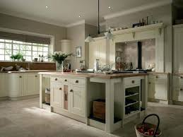 classic kitchen cabinets light brown tile wall round brass ceiling lights gloss wood floor cream white