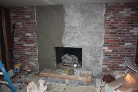 image of tile over brick fireplace basement