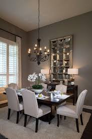 small formal dining room sets. highland homes - black chandelier, contrasting dining table, gray hue wall paint. small formal room sets