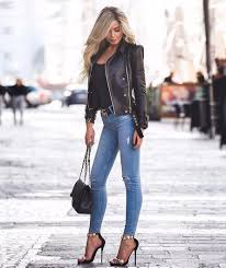 black leather jacket with blue jeans and heels