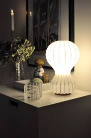 flos lighting soho. flos gatto brings a soft glow that complements the candlelight in this elegant interior. flos lighting soho