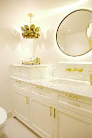 ivory and gold bathroom with lotus flower chandelier