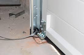 garage door cables may slip off the drum