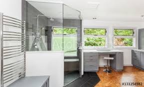 glass above pony wall and full height door with towel bar installed