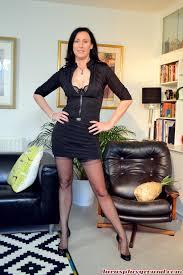 British porn milf Lara Latex opens long legs in classy stockings.