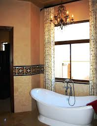 chandelier over bathtub lovely bathroom with curved and modern