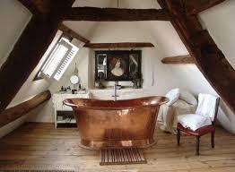 old fashioned attic bathroom design with gold free standing bathtub ideas