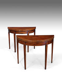 near pair of demi lune tables