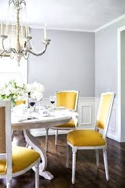 stunning dining room features gray walls paired with wainscoting framing french chandelier over round table surrounded