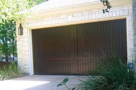 walnut garage doorsDark Walnut Stain on custom wood garage door  downtown Austin