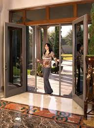 open french doors. install french doors w/ sliding screen - i think this would make the doorway open
