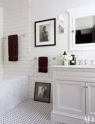 the tiles in the bath of designers richard lambertson and john truexs manhattan home are by