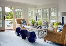 cottage living room with seagrass roll arm chairs and cobalt blue stools