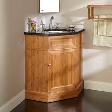 corner bathroom vanity with wooden cabinet and black bathroon vanity top also wall mirror