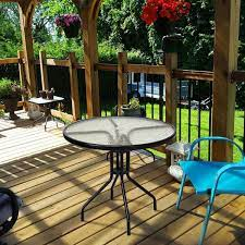 black round metal outdoor dining table