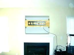 tv over a fireplace hanging over fireplace mounting over lace hang where to put cable box