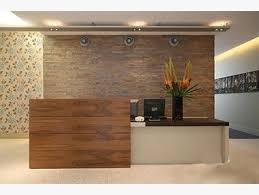 simple but an elegant reception desk in this office at charlotte street chi yung office feng