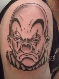 Grey Ink Jester Clown Tattoo On Inner Bicep