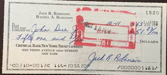 """A thread written by @TananariveDue: """"Pleasant turn this week: reporter (and  collector) @darrenrovell found a check signed by Jackie Robinson [...]"""""""