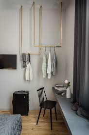 empty closet with hangers. Bold Hotel In Germany Custom Brass Clothes Hangers, Instead Of A Full Closet, Take Up The Empty Space Above Built-in Shelf. Closet With Hangers