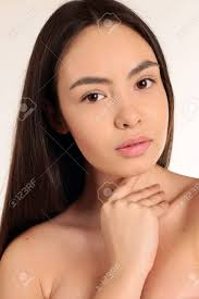 fashion studio photo of beautiful slim woman with dark hair and without makeup natural beauty