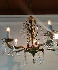 vintage 5 arm ornate smaller spanish brass chandelier with some amber crystals