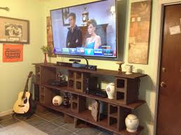 DIY shelves - cinder blocks, 1x8 and 1x6 pine board per shelf, stain,