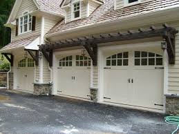 i love the shape of the windows on the garage doors the hardware gives it a nice touch also curbappeal schlagelocks