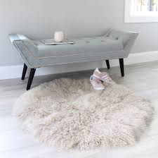 latte round mongolian fur area rug