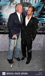 walking stick and his son Scott Caan ...