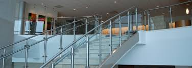 handrailing design utilizing stainless steel rails with glass infills in a  modern office setting