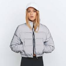 fila cropped hoodie. selling silver/grey fila reflective cropped puffer jacket, only worn once , open to offers but want at least 80 as that was the original price tags: hoodie