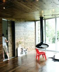 midcentury fireplace fireplace architecture hanging indoor electric fireplace wooden wall red chair large glasses wall wooden