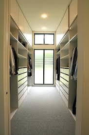walk in closet with window built in walk in closet idea in minimalist style grey rug