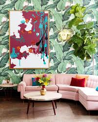 home decor trends 2018 bright bohemian living space with tropical print wallpaper and millennial pink