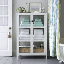 bathroom floor storage cabinets. Interesting Floor Ribbed White Bath Towel  Crate And Barrel Linen Cabinet In Bathroom Storage  To Bathroom Floor Cabinets G