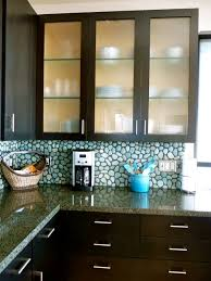 Cherry Wood Orange Zest Glass Panel Door Frosted Glass Kitchen Cabinets  Backsplash Pattern Tile Travertine Travertine Countertops Sink Faucet  Island
