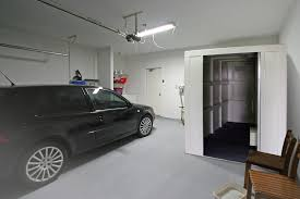 car parked next to a safe room in a garage