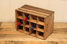 This easy DIY wine bottle crate holds up to 12 bottles of wine, making it  the perfect gift for the wine lover on your list. By making a few simple  cuts in ...
