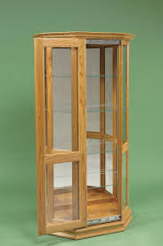 Amish Cabinet Doors Angled Curio Cabinet With Sliding Door From Dutchcrafters Amish